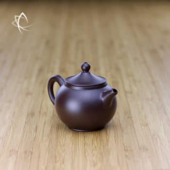 Hand Thrown Small Round Teapot with Marquee Shaped Lid Angled View